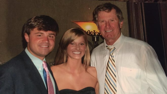 Thomas Hooper, here pictured with his wife Autumn and Steve Spurrier, played for Spurrier, who is retiring from coaching.