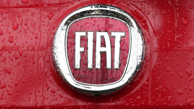 A Fiat logo is pictured on a car  in Milan, Italy.