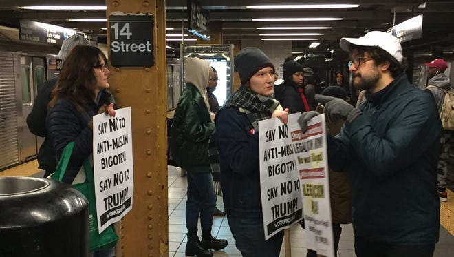 Protesters en route to John F. Kennedy International Airport on Saturday wait on the subway platform.