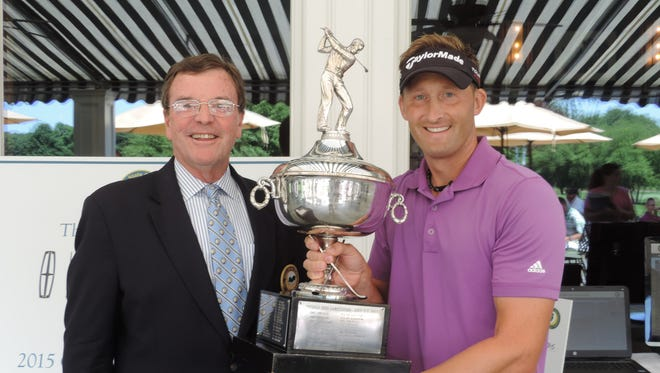 Two-time defending champion Tyler Hall (right) after winning the 2015 NJSGA Open Championship, with NJSGA president Frank O'Brien.