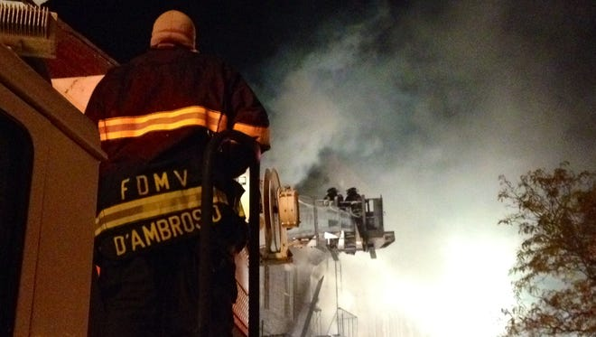 Firefighters battle blaze at 16 N. Bond St. in Mount Vernon on Nov. 14, 2014.