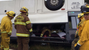 Firefighters inspecting crashed bus