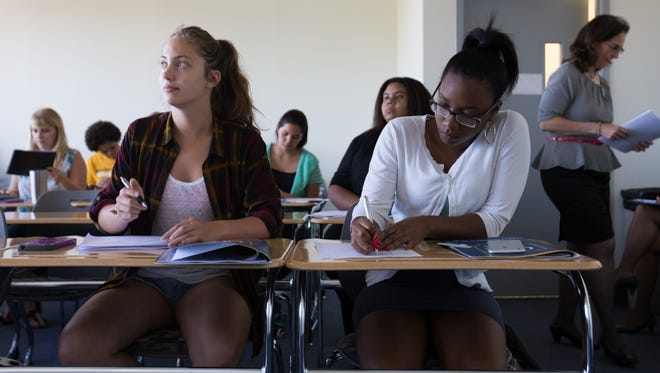 Goldey-Beacom College students Alecia Amadio, left, and Nicole Robinson take part in a salary negotiation workshop Thursday.
