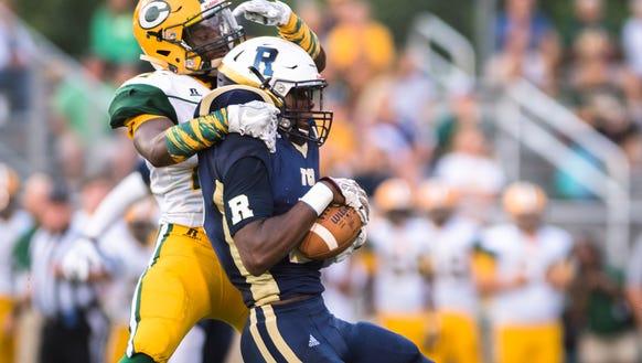 Roberson High School's Deonte Ellison intercepts a