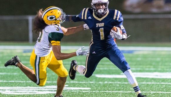 Roberson High School's Barshia Young runs the ball