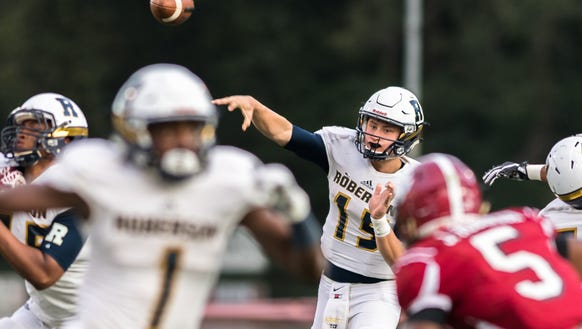 Roberson's Ty Gossett makes a pass during their game