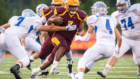 Cherokee high school's Isaiah Evans runs the ball during