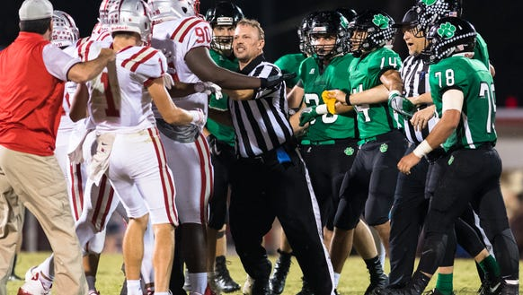The referee separates players from Hendersonville and