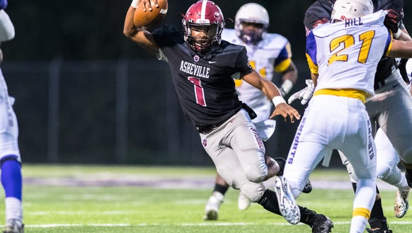 Asheville's Corey Clement runs the ball during their