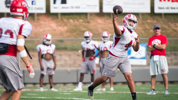 Erwin high school's quarterback, Kendrick Weaver runs