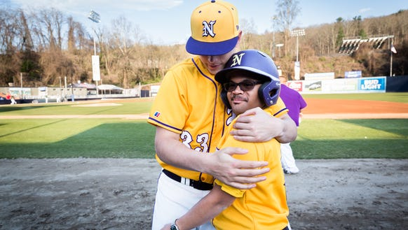 North Henderson's Gabe Murphy embraces teammate and