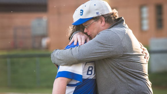 Bruce Kelley embraces his son Matthew Kelley of the
