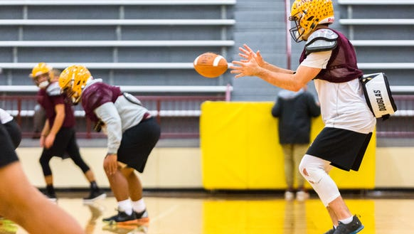The Cherokee high school football team practices in