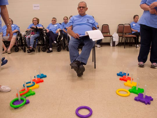 Boyd Moore of Boonville, Ind., keeps score during the ring toss portion of the Warrick County Southwest Indiana Regional Council on Aging (SWIRCA) Assisted Living and Nursing Home Games at the Chandler Community Center Wednesday morning.