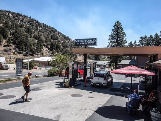Customers enter the Wrightwood Market in Wrightwood on Thursday, August 18, 2016. Many resident of the town of 5,000 remain despite orders to evacuate from the Blue Cut Fire.