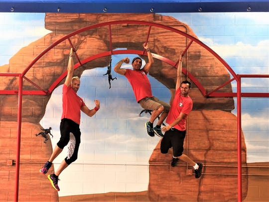 Washington County American Ninja Warrior competitors, from left, Brian Beckstrand, Jon Stewart and John Merrihew pose at their Ninja Warrior-themed gym, The Grip, which will open in Washington City next month.