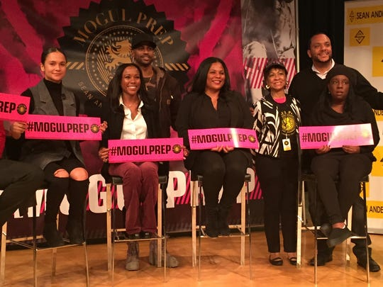 Big Sean and his mother, Myra Anderson (standing), join seated panelists Maurice Slade (Roc Nation), Courtni Asbury (Def Jam), Lindsey Lanier (Universal Music Publishing), Chaka Pilgrim (Roc Nation), Towalame Austin (Roc Nation) and Dennis Ashley (ICM) at the Mogul Prep event at Detroit's Charles H. Wright museum on Saturday, Nov. 7, 2015.