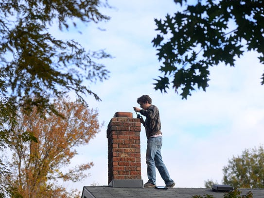 Justin Weber of The Chimney Guy takes measurements