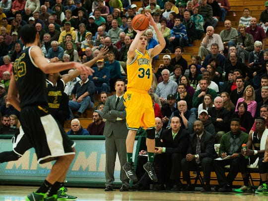 Vermont's Kurt Steidl takes a 3-point shot in the home