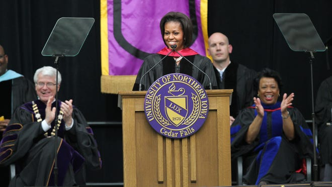 In this 2011 file photo, First Lady Michelle Obama exhorted graduates of the University of Northern Iowa.