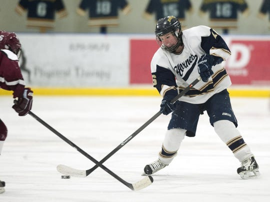 Essex's Avery MacGillivray (16) takes a shot during