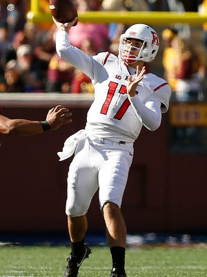 Rutgers quarterback Giovanni Rescigno throws a pass during the second half of an NCAA college football game against Minnesota, Saturday, Oct. 22, 2016, in Minneapolis. Minnesota won 34-32. (AP Photo/Stacy Bengs)
