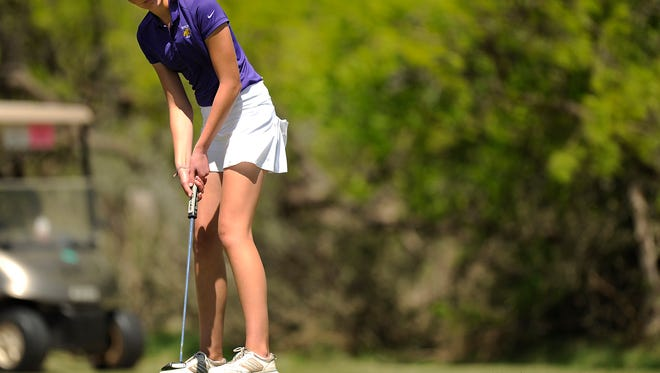 Wylie's Maddi Olson putts on the 13th hole of the District 5-4A golf tournament on Wednesday, March 29, 2017 at Diamondback Golf Club.