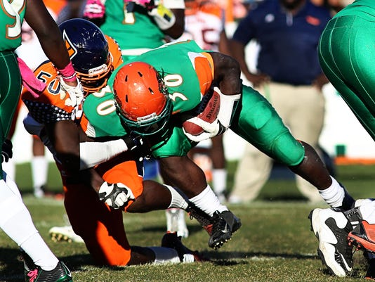 Gerald Hearns fights for extra yardage.jpg