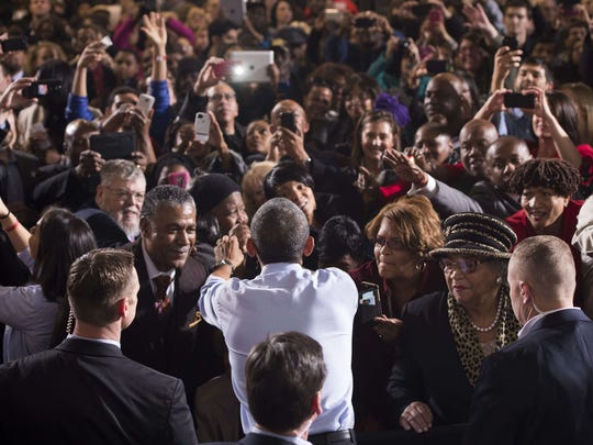 President Barack Obama greets supporters after speaking at a Nov. 1 campaign rally for Senate candidate Gary Peters and Michigan gubernatorial candidate Mark Schauer at the Matthaei Center at Wayne State University in Detroit.