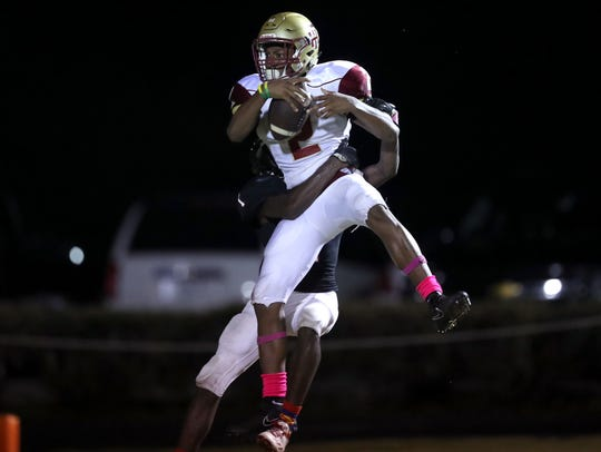 Florida High's Javan Morgan catches a touchdown pass
