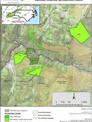 """This Nature Conservancy map of the Hickory Nut Gorge shows in bright green lands newly transferred to Chimney Rock State Park. The  """"Blue Rock"""" tract is shown as """"Thatcher"""" on the map."""