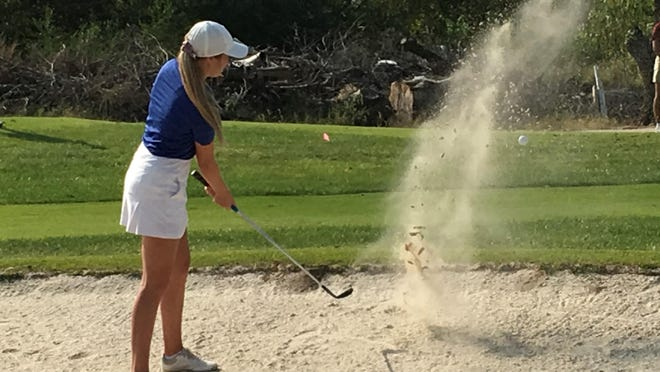 Washburn Rural senior Madelyn Luttjohann takes a shot from the sand in Monday's city golf tournament at Western Hills. Luttjohann won the city individual title with a 75, leading the Junior Blues to their eighth straight city team championship.