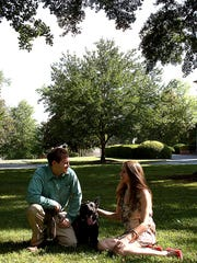 Brandon and Kristen King sit with their dog, Bono,