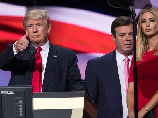 Manafort stands between Donald Trump and Ivanka Trump during a walkthrough at the Republican National Convention in Cleveland on July 21, 2016.