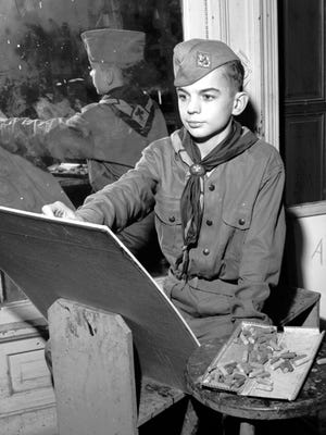 """Gary Grantham, 14, of 107 Law, sits before his drawing board on Jan. 6, 1953, working toward the future. Gary, also a Boy Scout, has been drawing for as long as he can remember and hopes someday to be a """"real artist."""" His early efforts give real promise of his dreams coming true some day."""