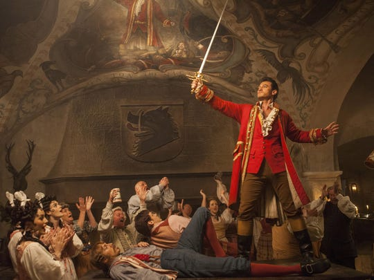 "Gaston (Luke Evans) a handsome but arrogant brute, holds court in the village tavern in ""Beauty and the Beast."""