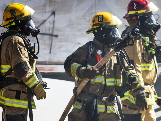 Phoenix firefighters battle a blaze on September 5,