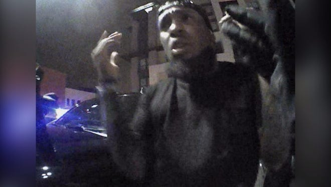 Video still of Cardinals' Chris Clemons questioned by police outside Scottsdale nightclub