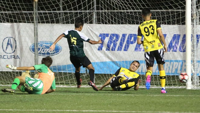 NAPA Rovers central defender Francis Chargualaf manages to clear the ball on the goal line following a shot attempt by Bank of Guam Strykers D2's Micah Hennegan in a Round 1 match of the Bank of Guam 10th Annual GFA Cup men's soccer tournament Tuesday May 2, 2017, at the Guam Football Association National Training Center. The Rovers won 9-1.