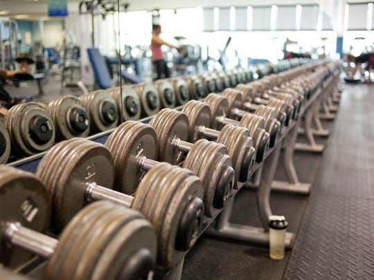 Free weights sit on a rack September 25, 2014 at Cutting Edge Health and Fitness in Port Huron.