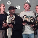 Hootie & The Blowfish, from left, Jim Sonefeld, Darius Rucker, Mark Bryan and Dean Felber, show the two Grammys they won in 1996. The four former University of South Carolina students had just hoped to make a living playing music to put off getting real jobs.