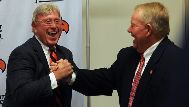 Carson-Newman athletic director Allen Morgan, left, introduces new football coach Mike Turner on Tuesday in Jefferson City.