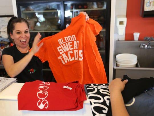 Monique Garcia, a waitress at Southside Barbacoa, looks
