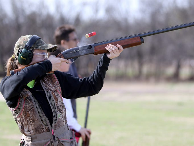 Twelve-year-old Casey Carrion tracks a clay pigeon