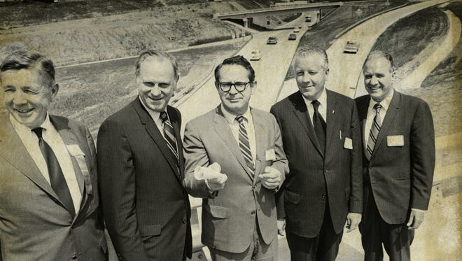 Officials celebrate the 1970 opening of the portion I-240 that runs from I-40 in West Asheville to Patton Ave. It would be another decade before the interstate got through the Beaucatcher Cut.