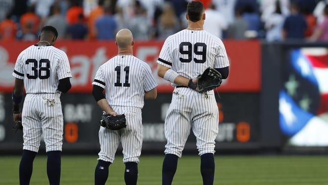 Cameron Maybin (38), Brett Gardner (11), and right fielder Aaron Judge (99) stand for the national anthem at Yankee Stadium last season. The restart of sports may be the right time to end the pregame ritual. KATHY WILLENS/AP