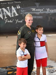 U.S. Air Force Col. Andrea Themely is photographed with her sons, Josh and Jake, following her final flight as an Air Force pilot. Per tradition, Themely was hosed down by friends and family after she got out of her T-38 Talon on the flight line of Sheppard Air Force Base where she is the commander of the 80th Flying Training Wing.