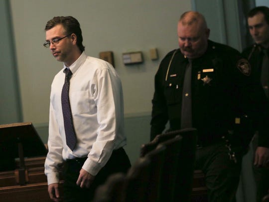 Defendant Shawn Grate is escorted back into the courtroom