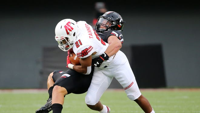 Cincinnati Bearcats linebacker Jaylyin Minor (33) tackles Austin Peay Governors running back Ahmaad Tanner (21) in the first quarter during the college football game between the Austin Peay Governors and the Cincinnati Bearcats on Aug. 31 at Nippert Stadium.