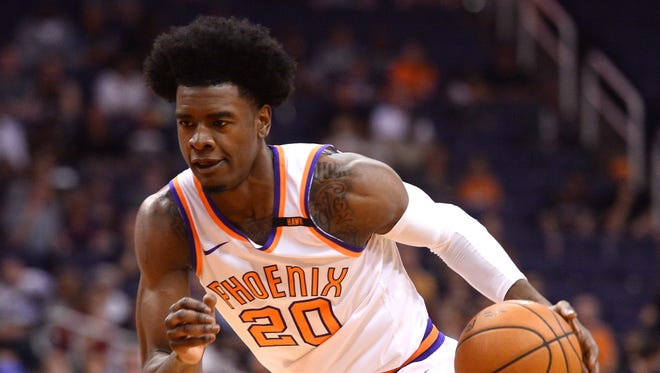 Apr 6, 2018; Phoenix Suns guard Josh Jackson (20) dribbles against the New Orleans Pelicans during the first half at Talking Stick Resort Arena.